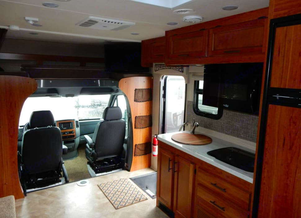 Large interior, Large refrigerator, plenty of space and overhead sleeping area, dining room has a double bed and back of RV has a Queen bed.. Jayco Melbourne 2017