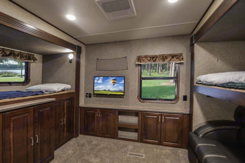 Spacious bunk room with lots of storage, it's own tv, half bathroom, and couch (that also folds out into a double bed). . Heartland Gateway 2017