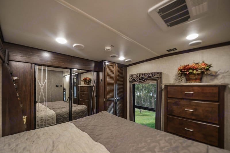 Relaxing master bedroom with a spacious closet, washer and dryer, dresser and beautiful big window. . Heartland Gateway 2017