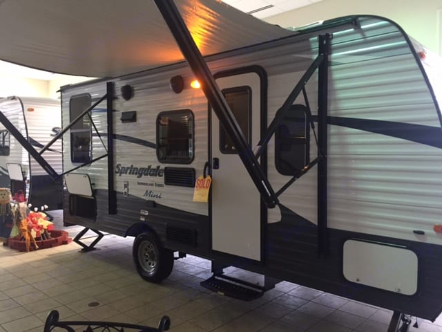 The RV with it's awning out on the showroom floor when first purchased in February 2017.. Keystone Springdale 2016