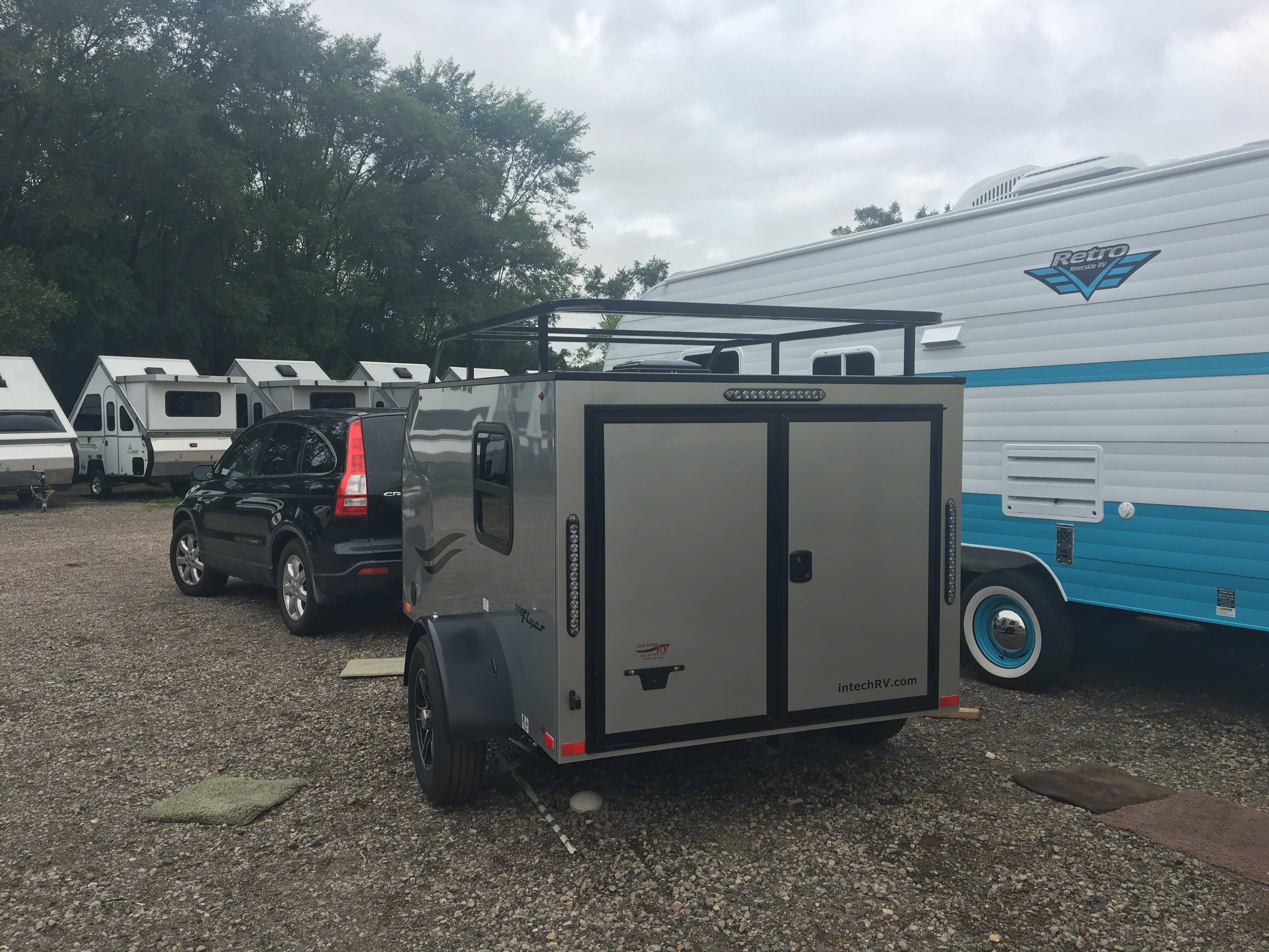 Double doors in the back open completely. Receiver hitch can hold 200 lbs. Use the roof rack to transport your bike!. Intech XLT Flyer 2017