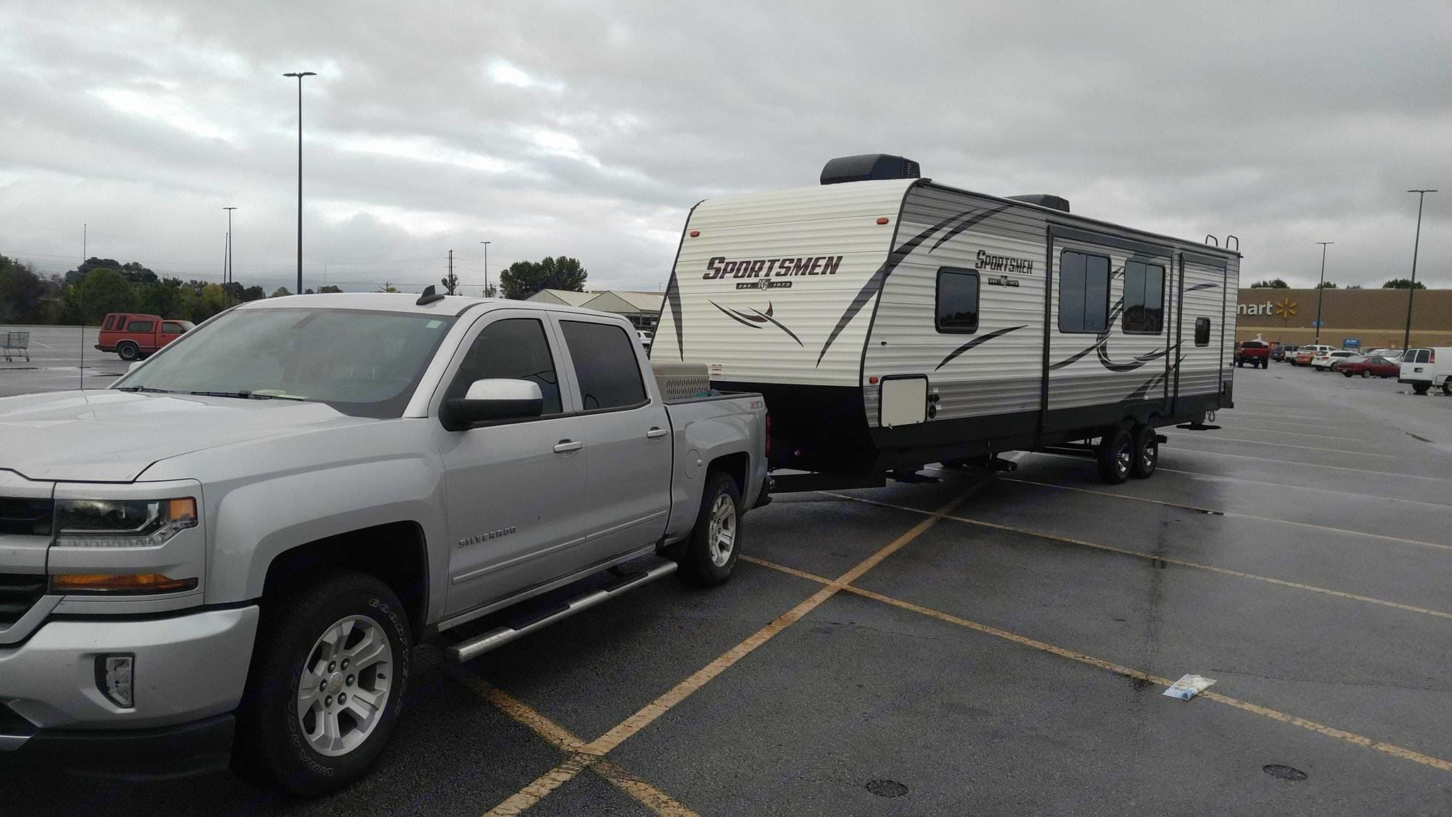 Us stopping at Walmart towning our camper home. K-Z Manufacturing Sportsmen 2018