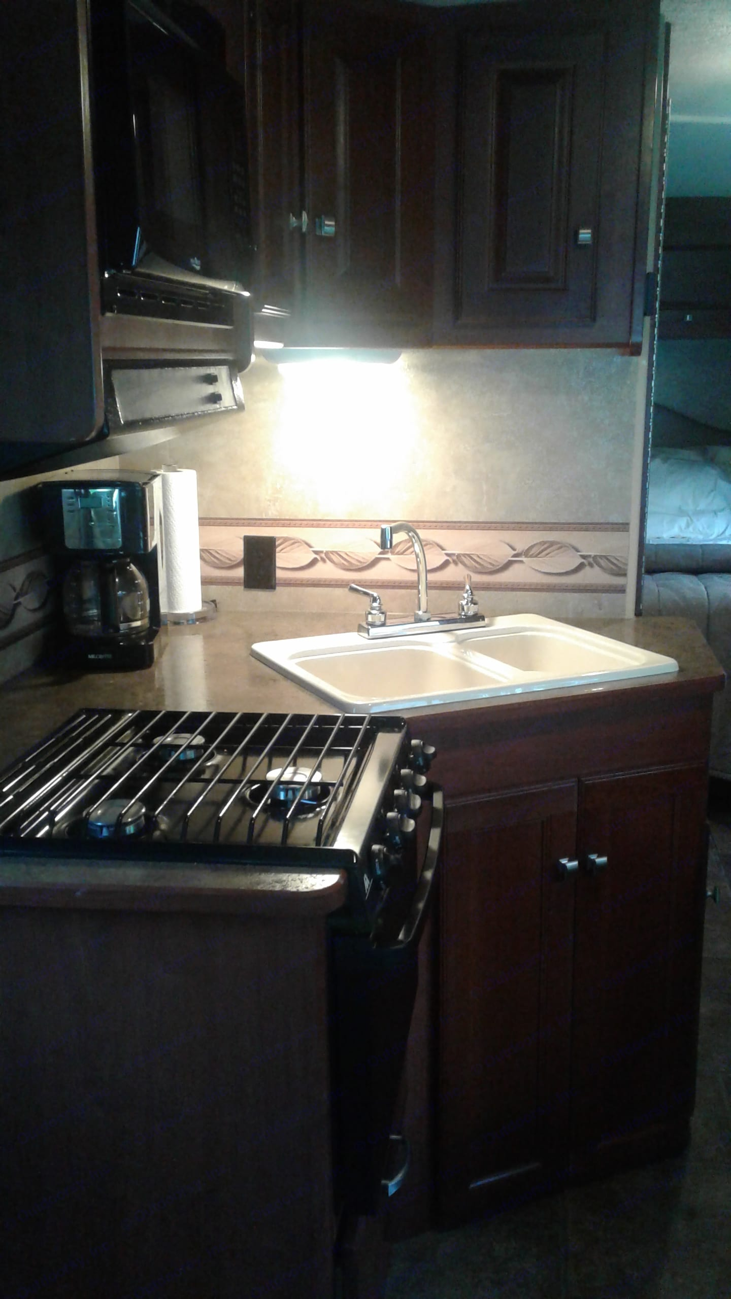 Stove w/3  and oven, Micro wave, Coffee Maker, cabinets filled with everything from Pots and pans, skillets, silverware to dishes. . Winnebago Vista 2013