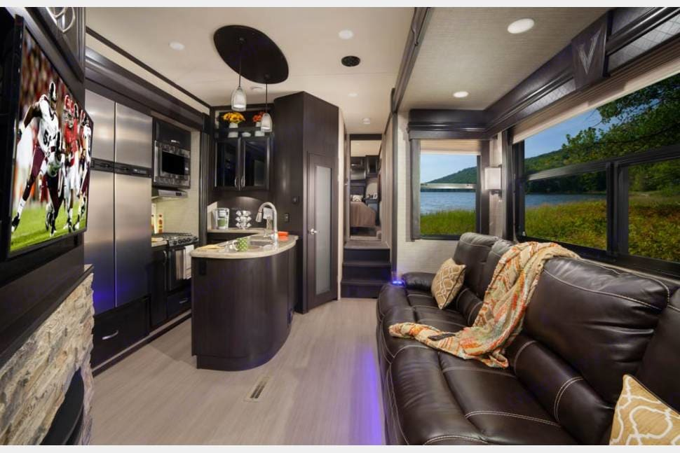 Featuring a large reclining couch (with massage & heat), large flat screen TV, Fireplace, and spacious kitchen with lots of storage.. Dutchmen Voltage 2017