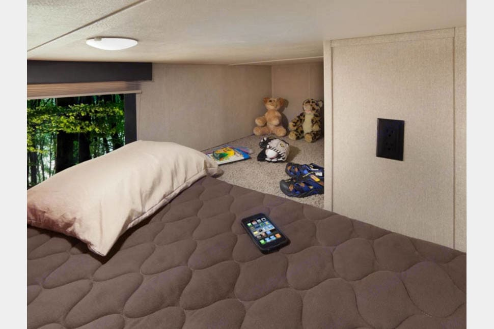 Loft bed features a twin size bed, as well as cubby for personal items. Kids really enjoy making this their hide-away space. . Dutchmen Voltage 2017