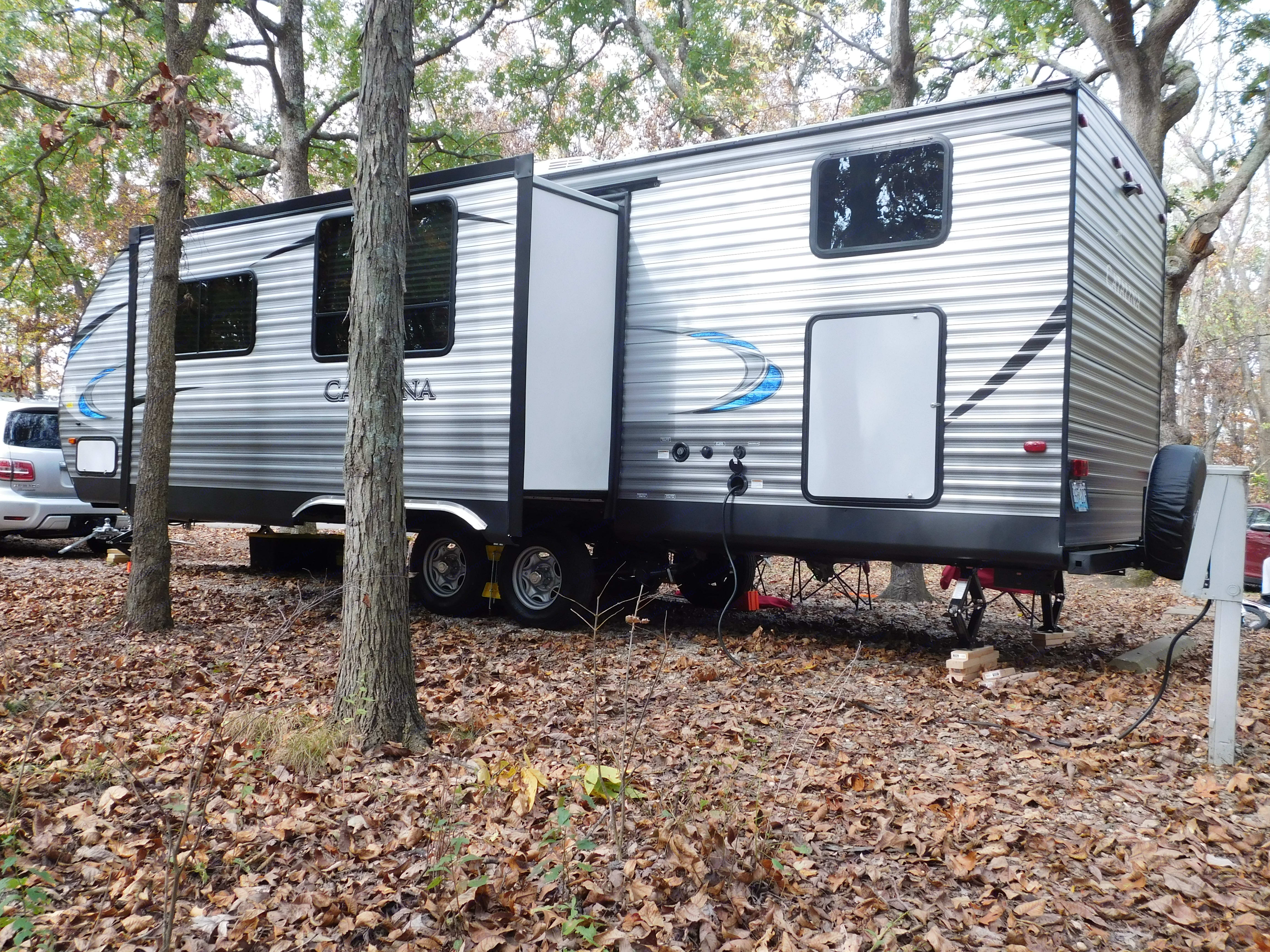 Slide out opens up the kitchen and living area.. Coachmen Catalina SBX 2018