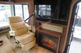 TV/Fireplace with Captain Chairs. Fleetwood Bounder 2013