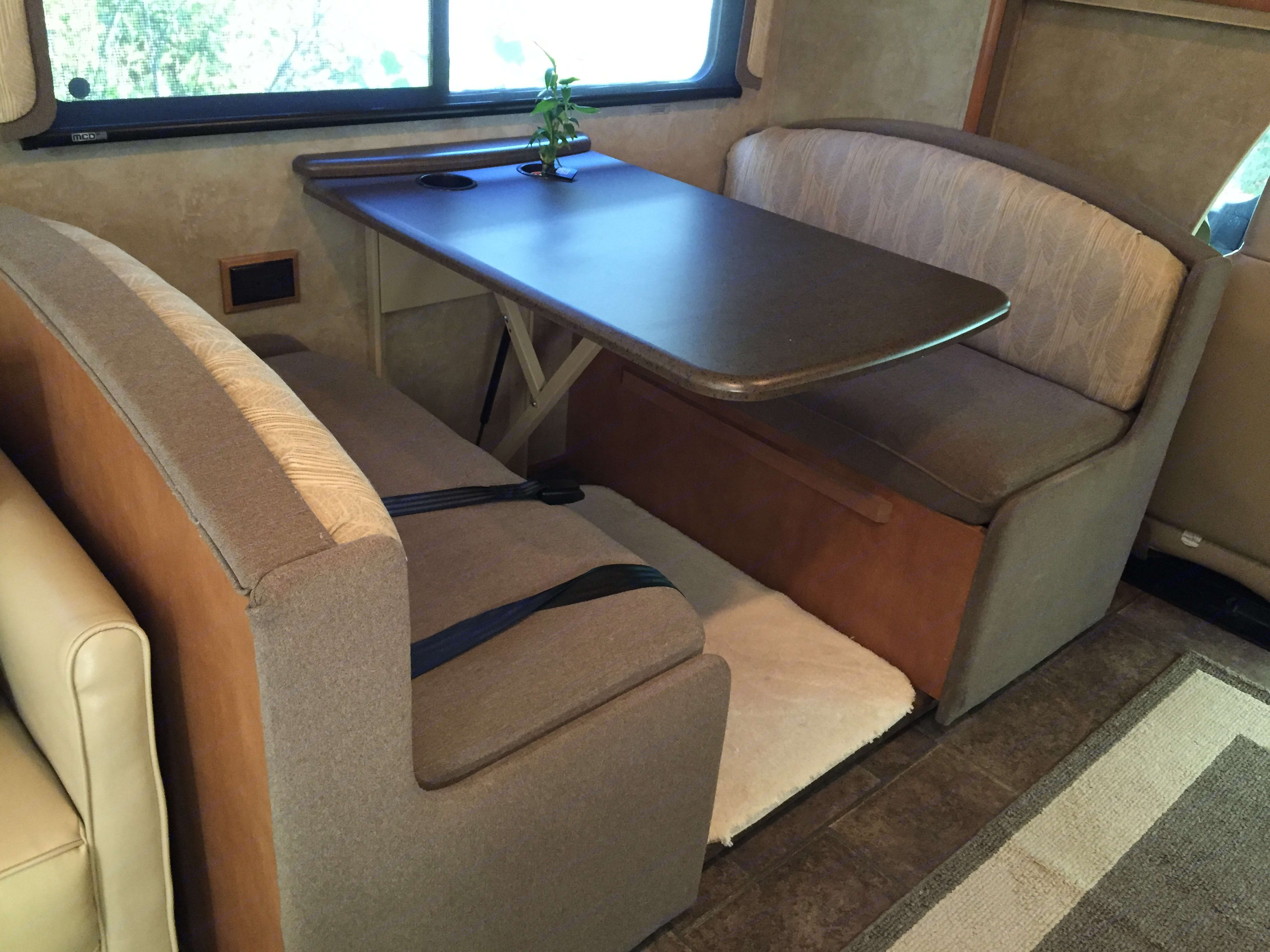 Dining table lowers to make a bed for the kids.. Winnebago Access 2013