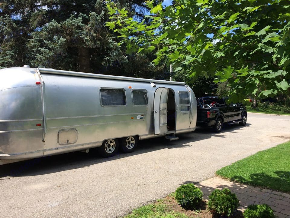 Packed up, and about ready to roll out!. Airstream Land Yacht 1969
