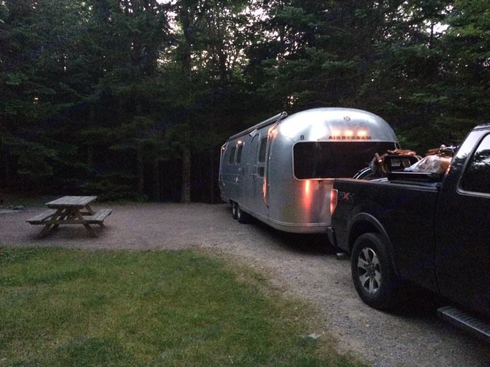 Backing into a campsite. Airstream Land Yacht 1969