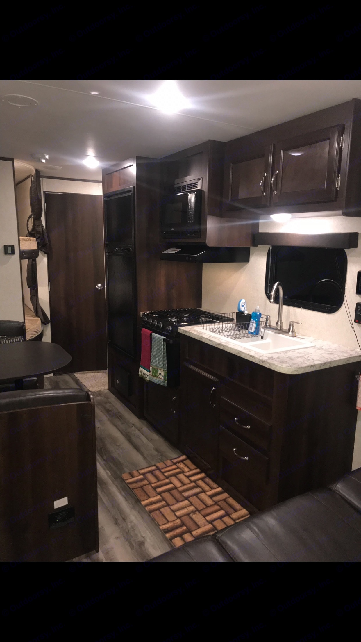 Kitchen Area with Large Fridge / Freezer, 3 Burner Stove, Microwave, Dual Sinks for Easy Clean Up & Small Oven for Rainy Days . Jayco Jay Flight 2018
