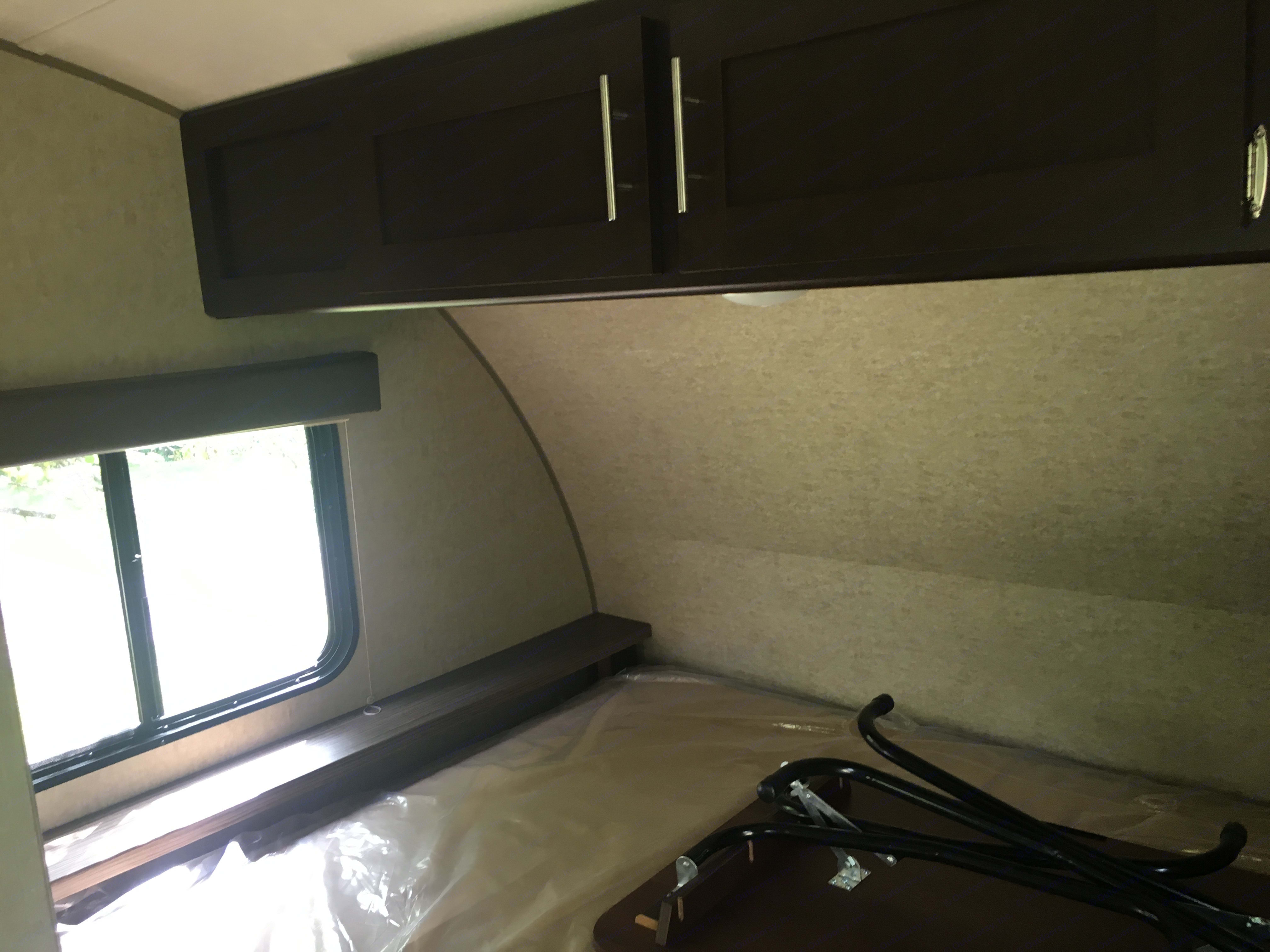 Queen-size bed with overhead storage.  . Forest River Wolf Pup 2017
