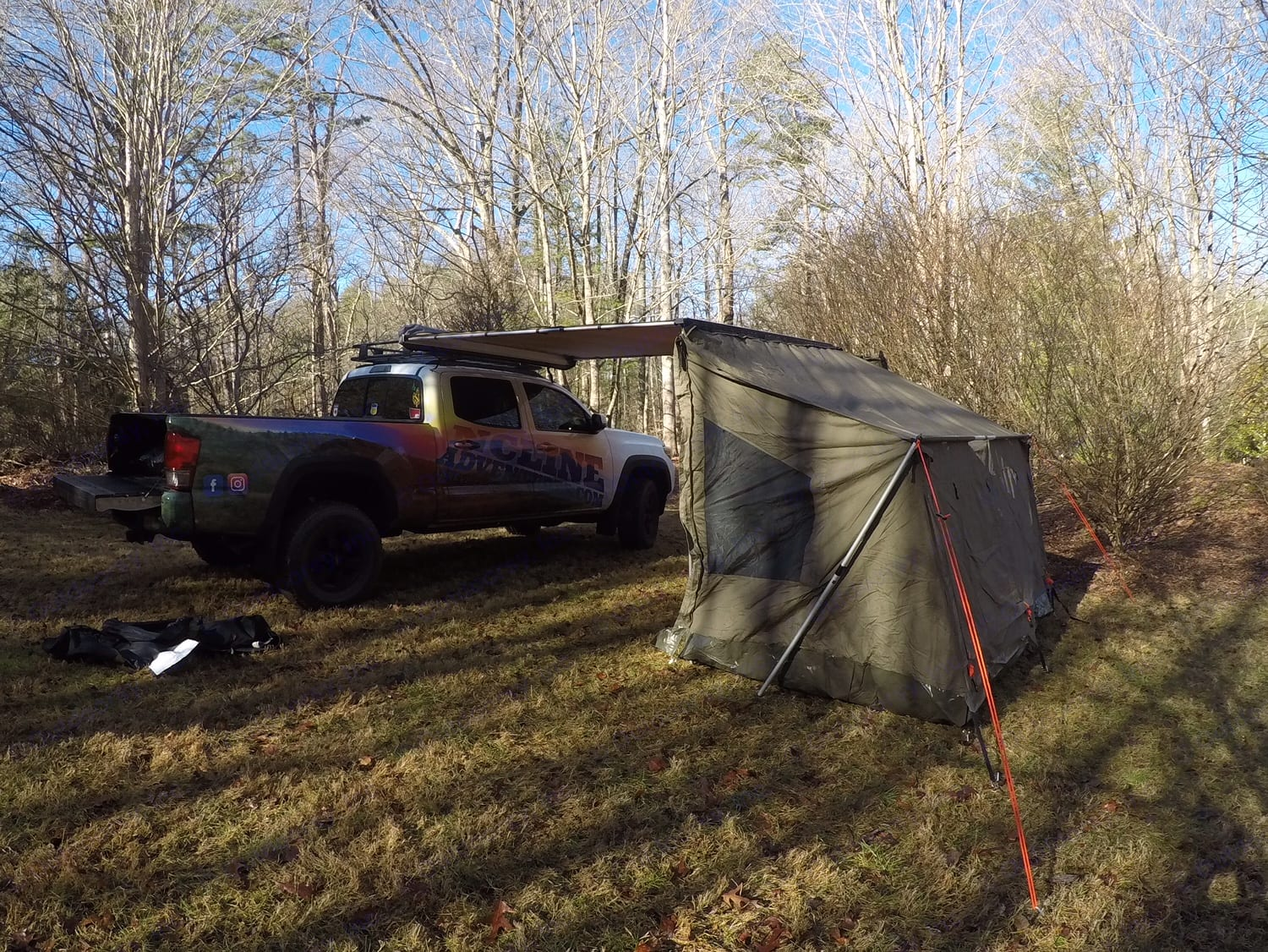 Here is the truck with the 3 man tent attached at a campsite. It is the perfect fit for any site, leaving you lots of room to chill near the fire, grill out or play some games. You can also hang out under the awning. You enter in the tent from underneath the awning so you are sure to stay dry and in the shade. Toyota Tacoma 2016