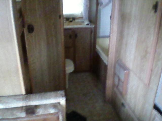 Full bathroom with sink, toilet, bathtub and shower.. Heartland Prowler 1983