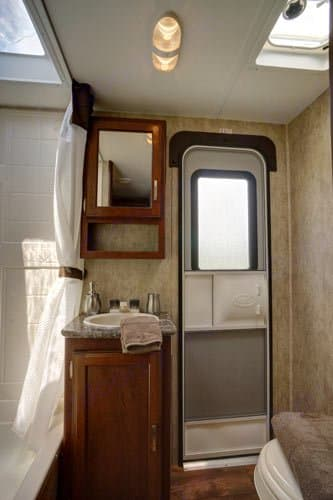 The bathroom features exterior access as well as a shower with upgraded shower head. . Keystone Passport 2014