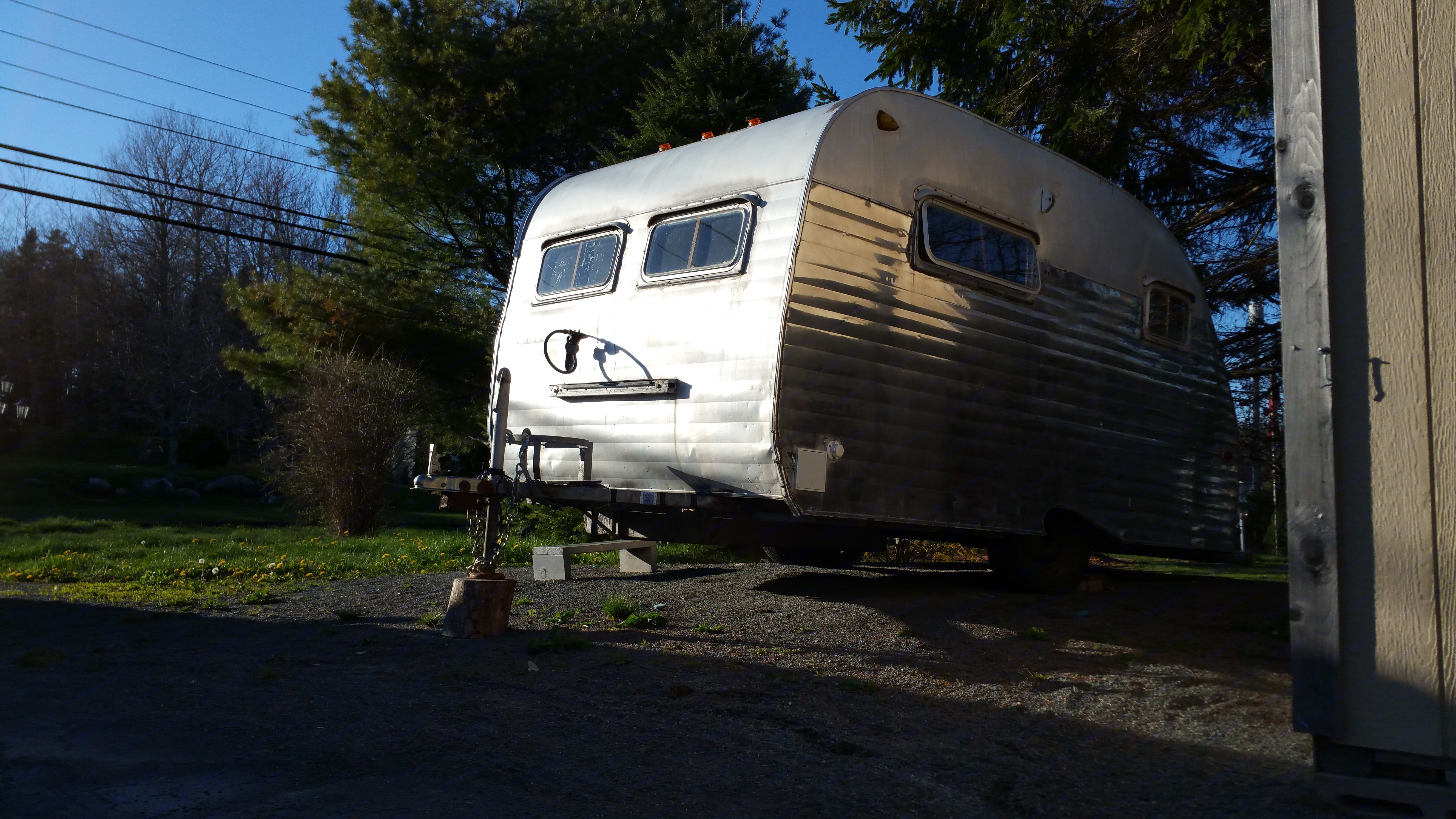 Grace is a true survivor - she has had 57 years to work on her patina, and has earned each of her exterior dents and dings.   Her interior has been lovingly rebuilt in a custom design to allow more space than she originally had. . Serro Scotty Sportsman 1961