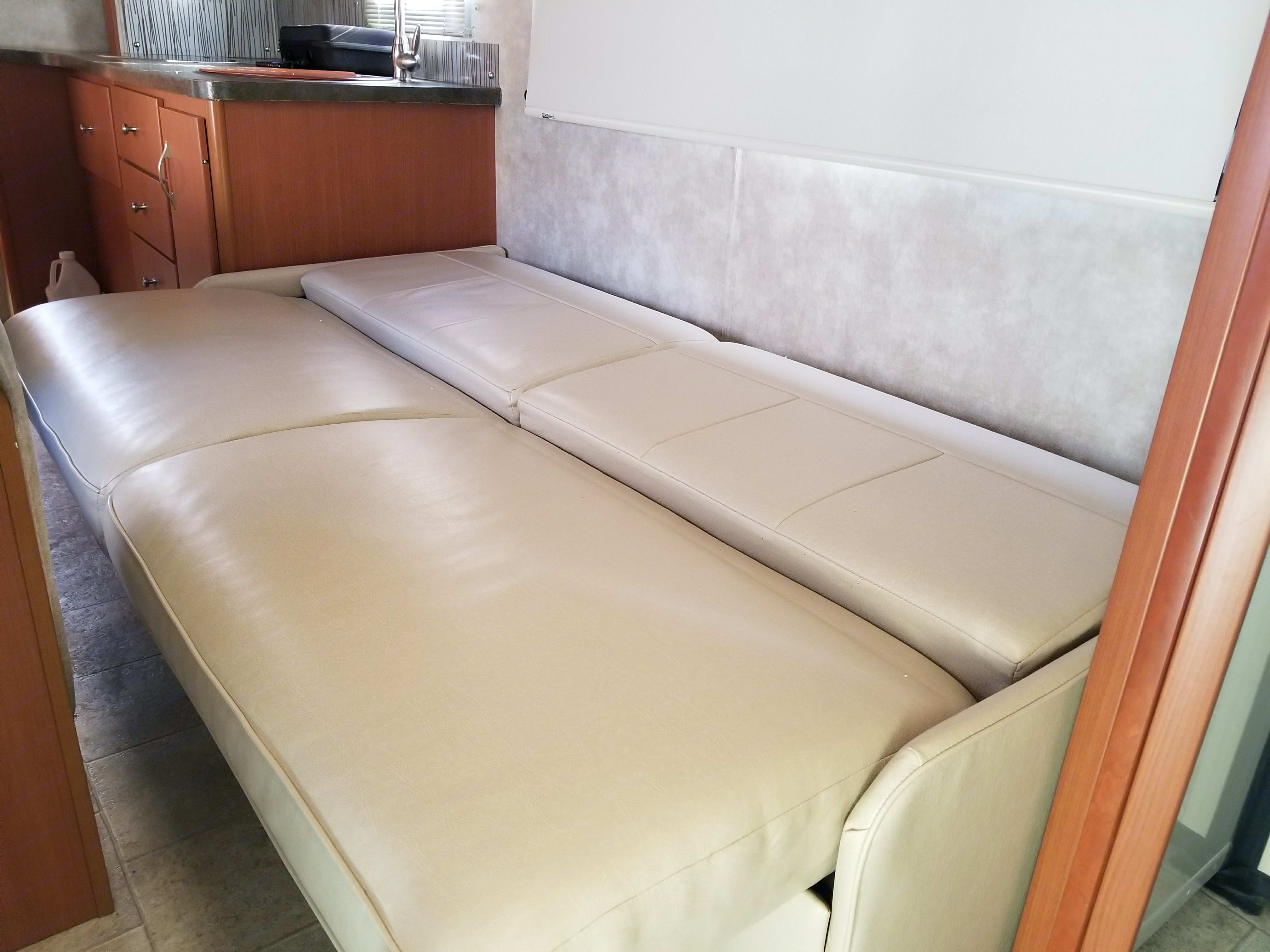 couch folded down into bed. Winnebago View 2011