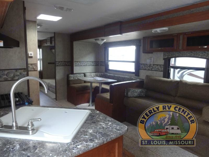 2 tip out,  dining area and living space. All folds down for sleeping. Keystone Passport 2015