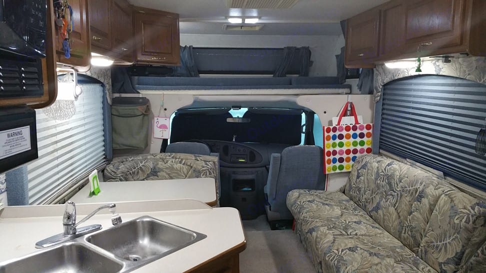 Living area and bed over cab up to 300 pounds. Dutchmen Express 2002