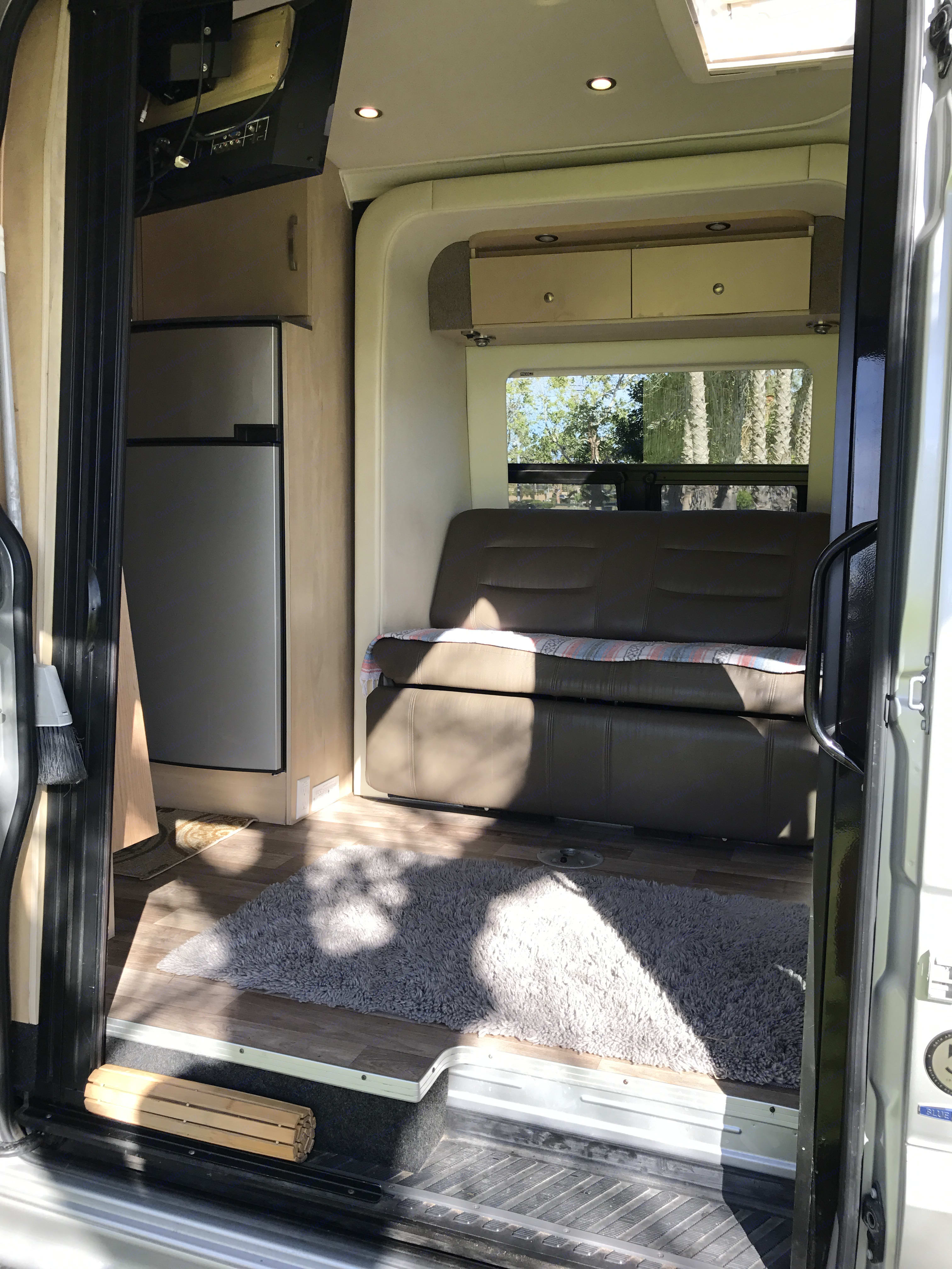 Living space.  Look at the size of that fridge and freezer! . Leisure Travel Free Spirit 2016