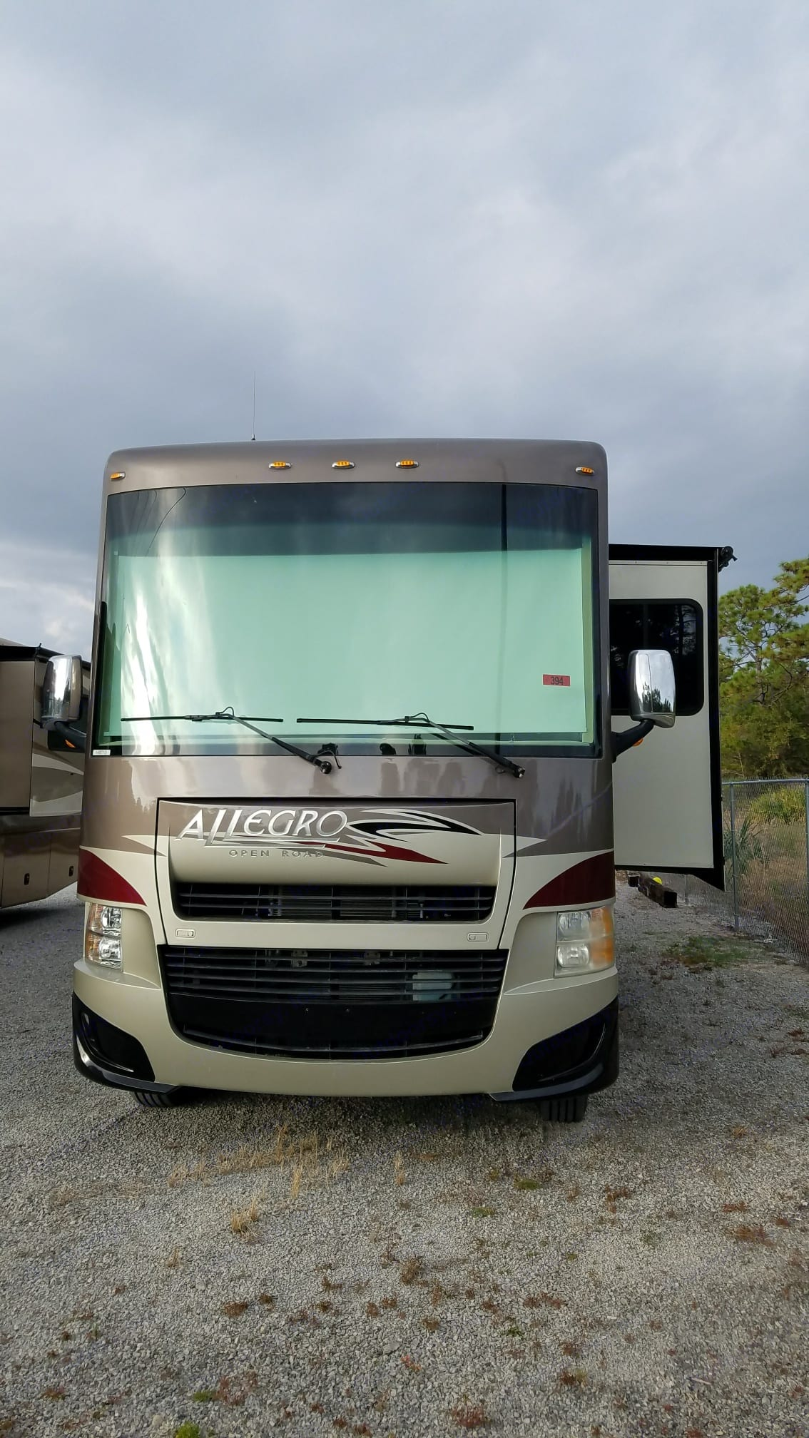Front with drop down privacy, night shades. Tiffin Motorhomes Allegro Open Road 2013