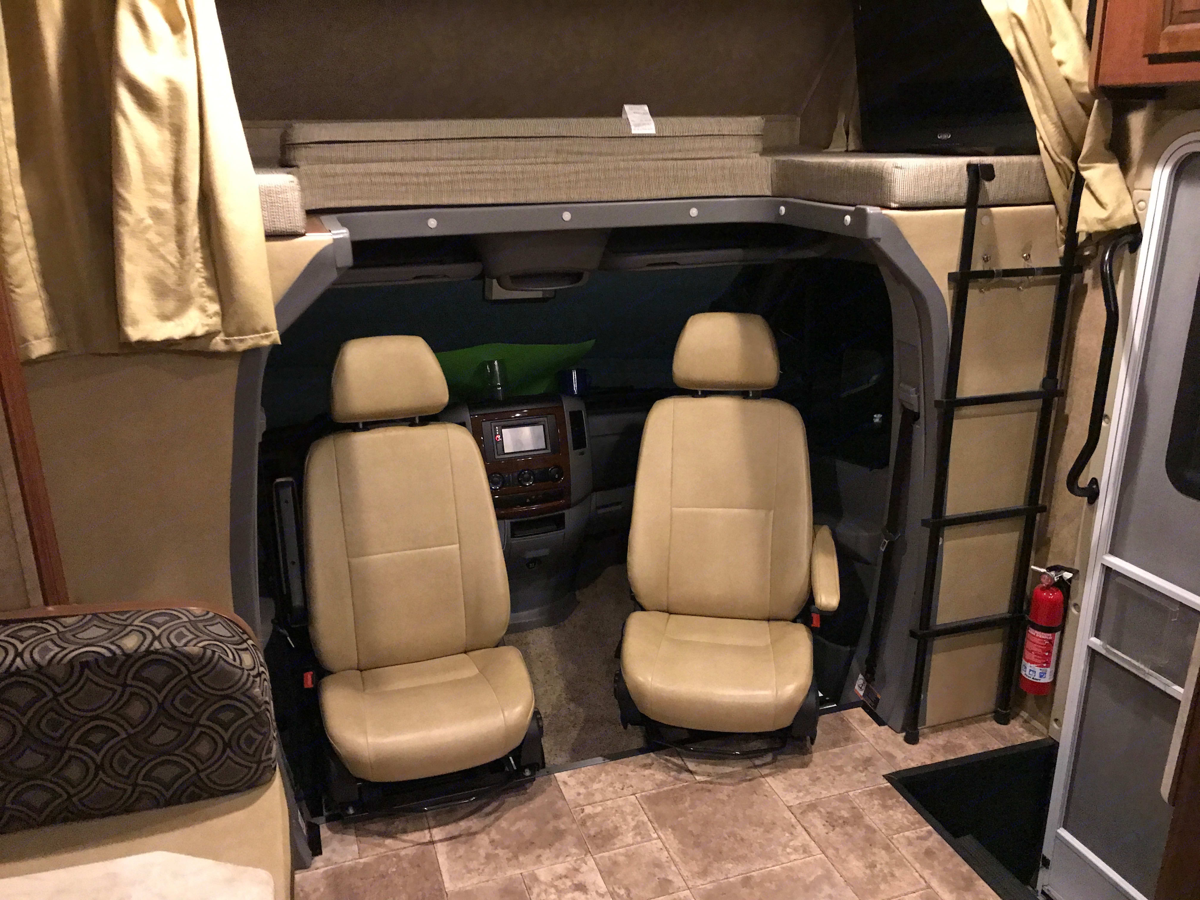 Driver and Passenger seats swivel for additional seating. Forest River Solera 24S 2015