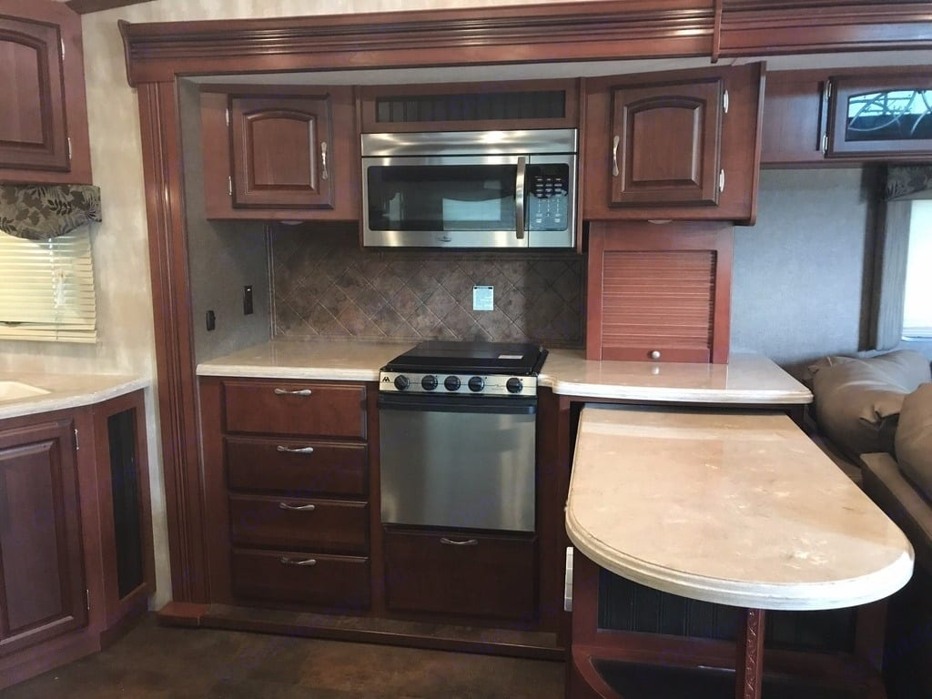 Large kitchen with side by side refrigerator and nice island.. Winnebago Latitude 2015