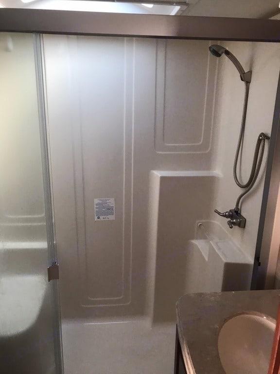 Large walkin shower with seat. Winnebago Latitude 2015