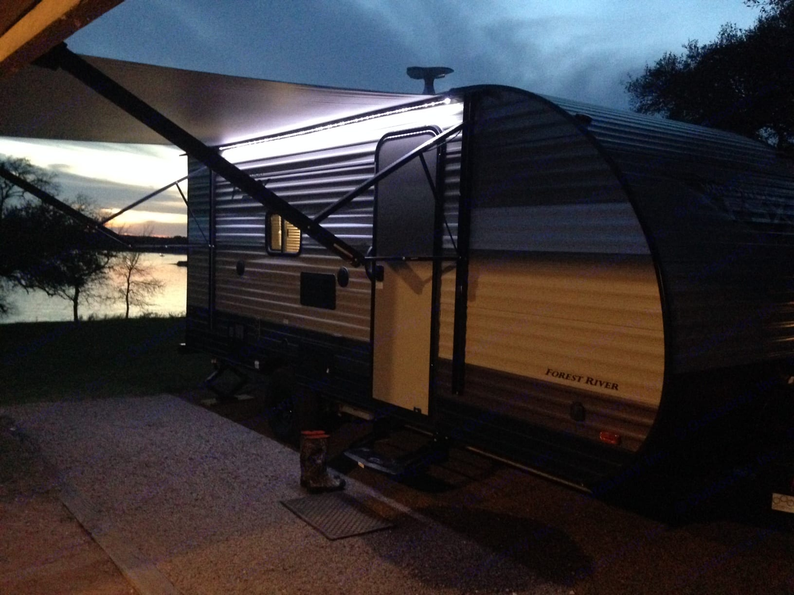 Large electric awning and outdoor lighting makes evenings by the lake an absolute breeze.. Forest River Wildwood X-Lite 2018