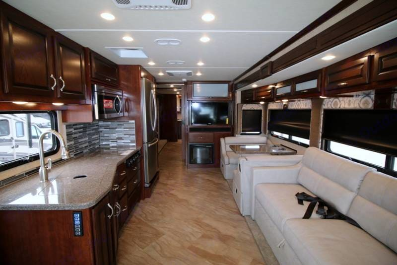 Large main room with full kitchen features, a full-size refrigerator with french doors and bottom freezer. There is a fireplace/heater for the main room, and there is Blueray/Satellite tv. There is a per-month activation/usage fee for satellite.. Fleetwood Bounder 2017