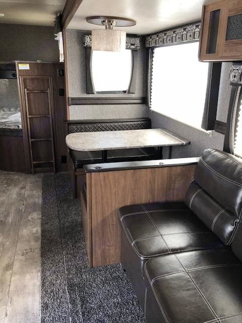Slide out has table and couch. Pioneer Bunkhouse 2018