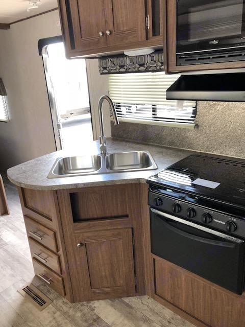Kitchen has double sink. Pioneer Bunkhouse 2018