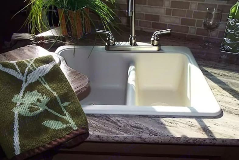 Double-sided sink in kitchen, granite-finish countertops.. Cruiser Rv Corp Radiance 2015