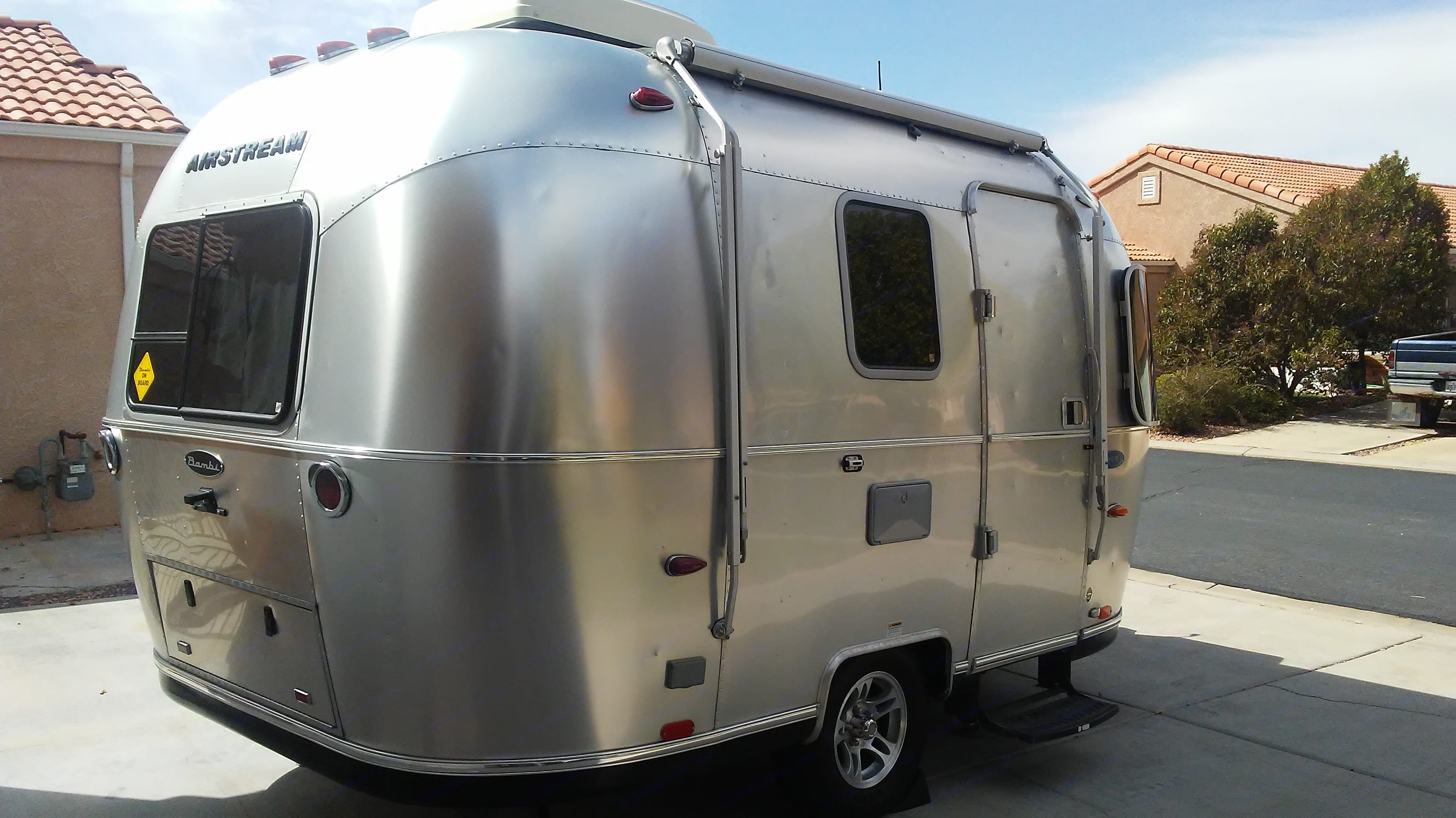 Right side with awning and door. Airstream Sport Bambi 2015