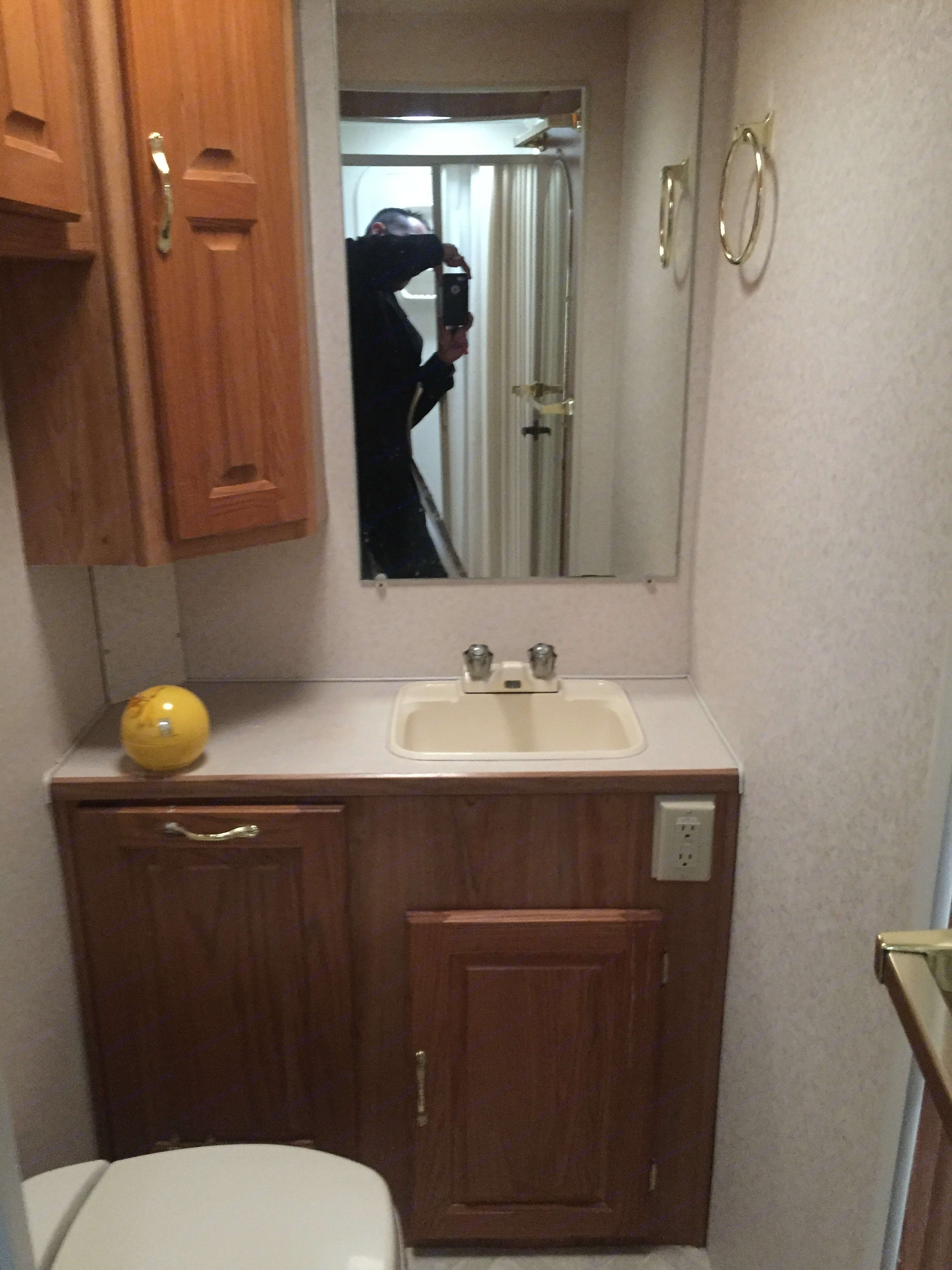 Did I mention that your bathroom has its own sink and mirror so that way you can get prepped for your event or for your outing for that perfect photo… Be prepared for the memories that will last a lifetime. coachman Santara 2001