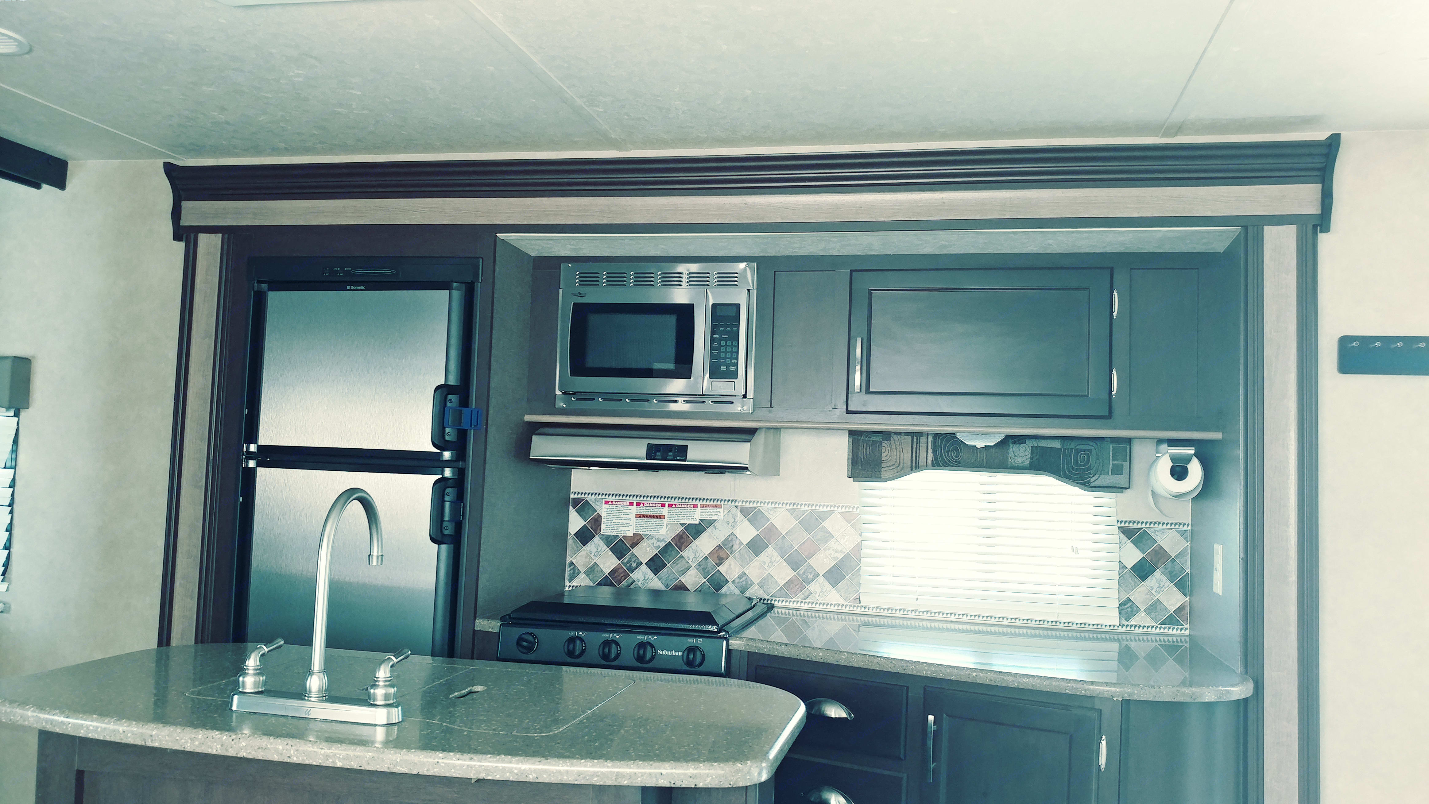 Kitchen. Includes pots, pans, coffee maker, utincils. Also the rest of the usual kitchen stuff. Forest River Evo 2016