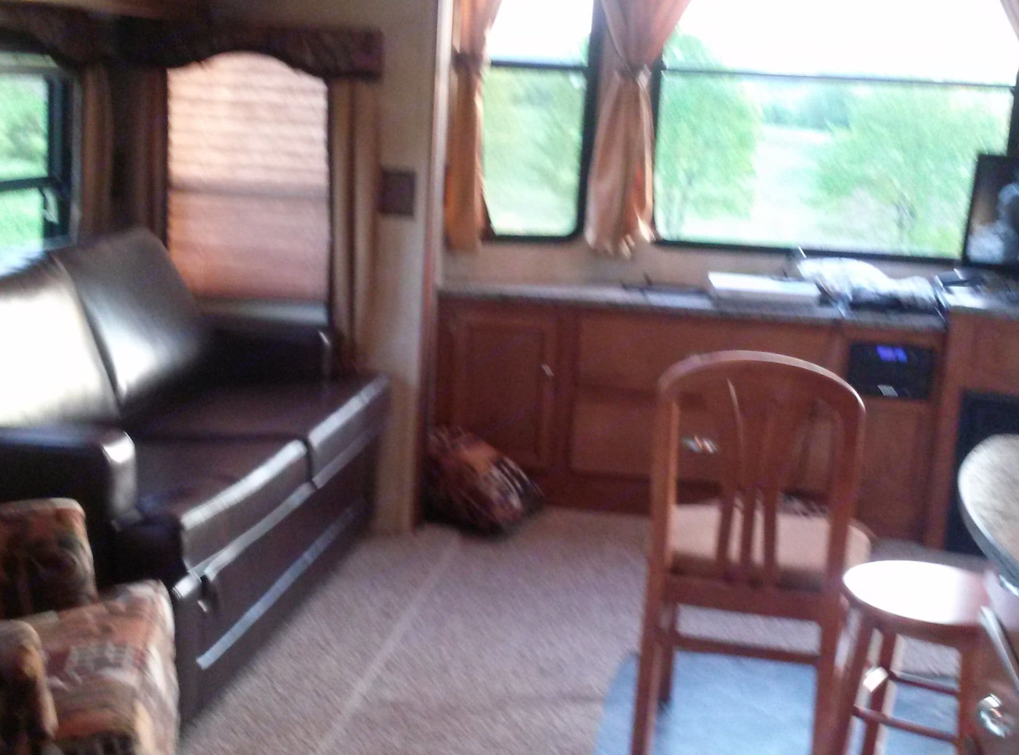 Living room and fullsize pullout bed.. Keystone Residence 2013