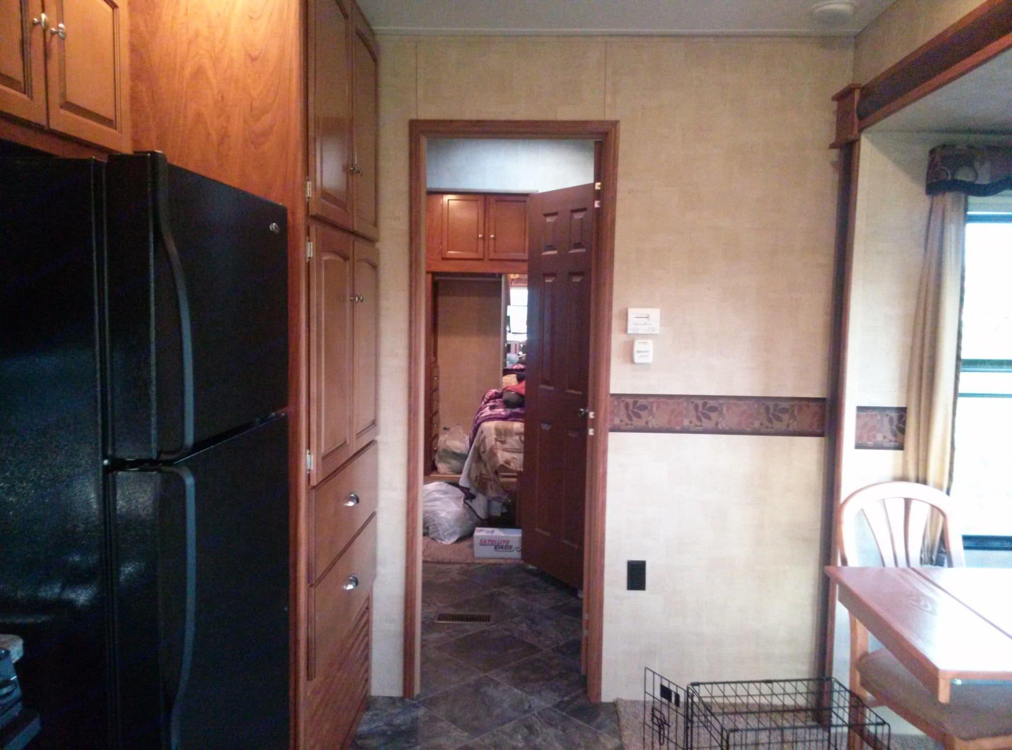 Hallway and full size fridge on left.. Keystone Residence 2013