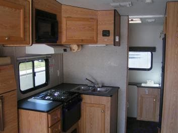 Full kitchen , big shower in bathroom. Carson Trailer Fun Runner 2007