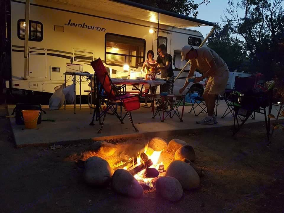 Outdoor with Awning at night. Fleetwood Jamboree 23e 2002