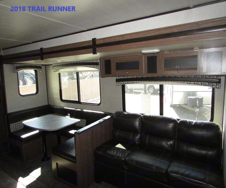Dinette and Couch convert into twin beds.. Heartland Trail Runner 2018