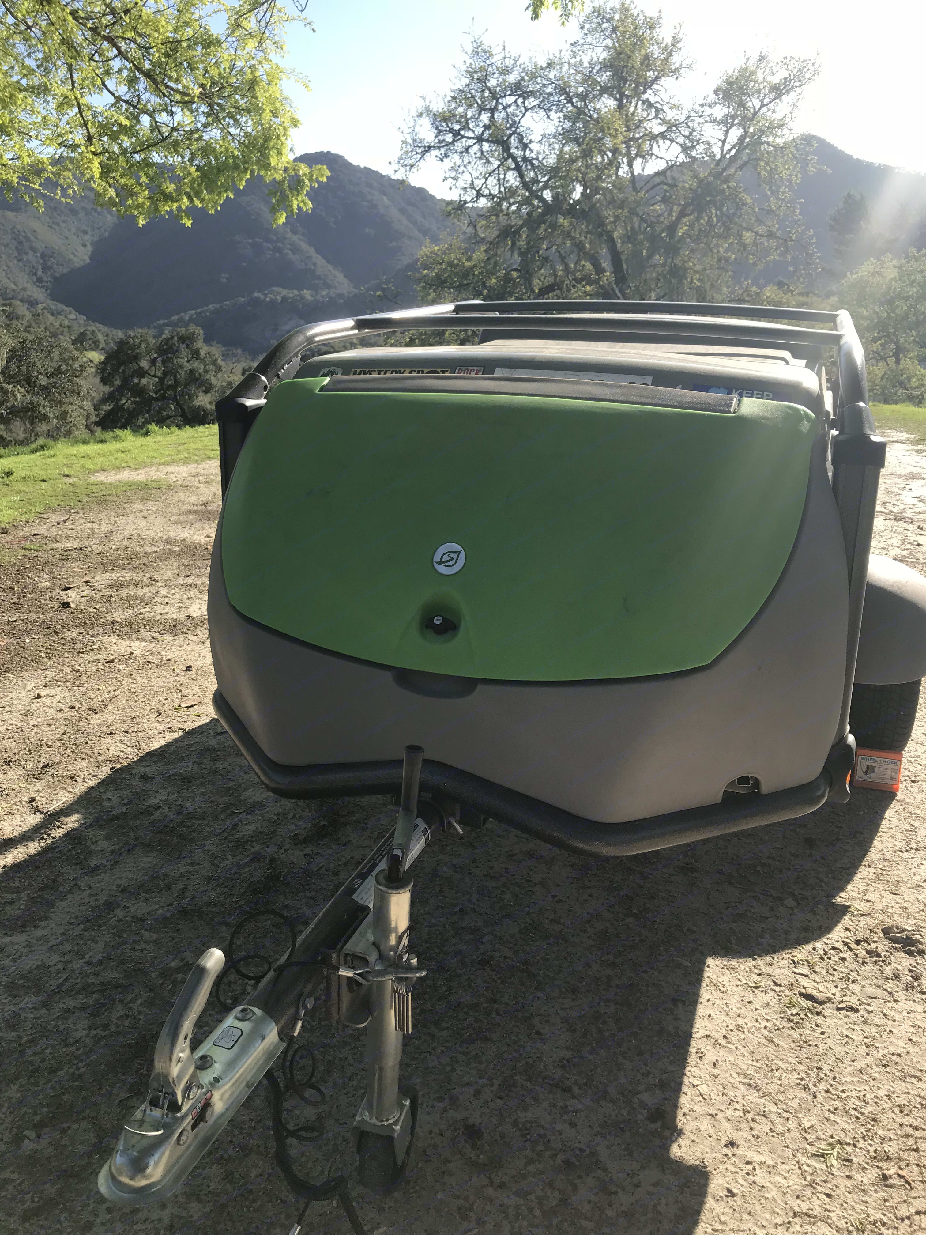 All secured and ready to roll ! This camper has a small footprint when closed up, allowing for aerodynamic towing. The green door opens to reveal trunk space where we store the mattresses, camp chairs, and more. SylvanSport GO 2015