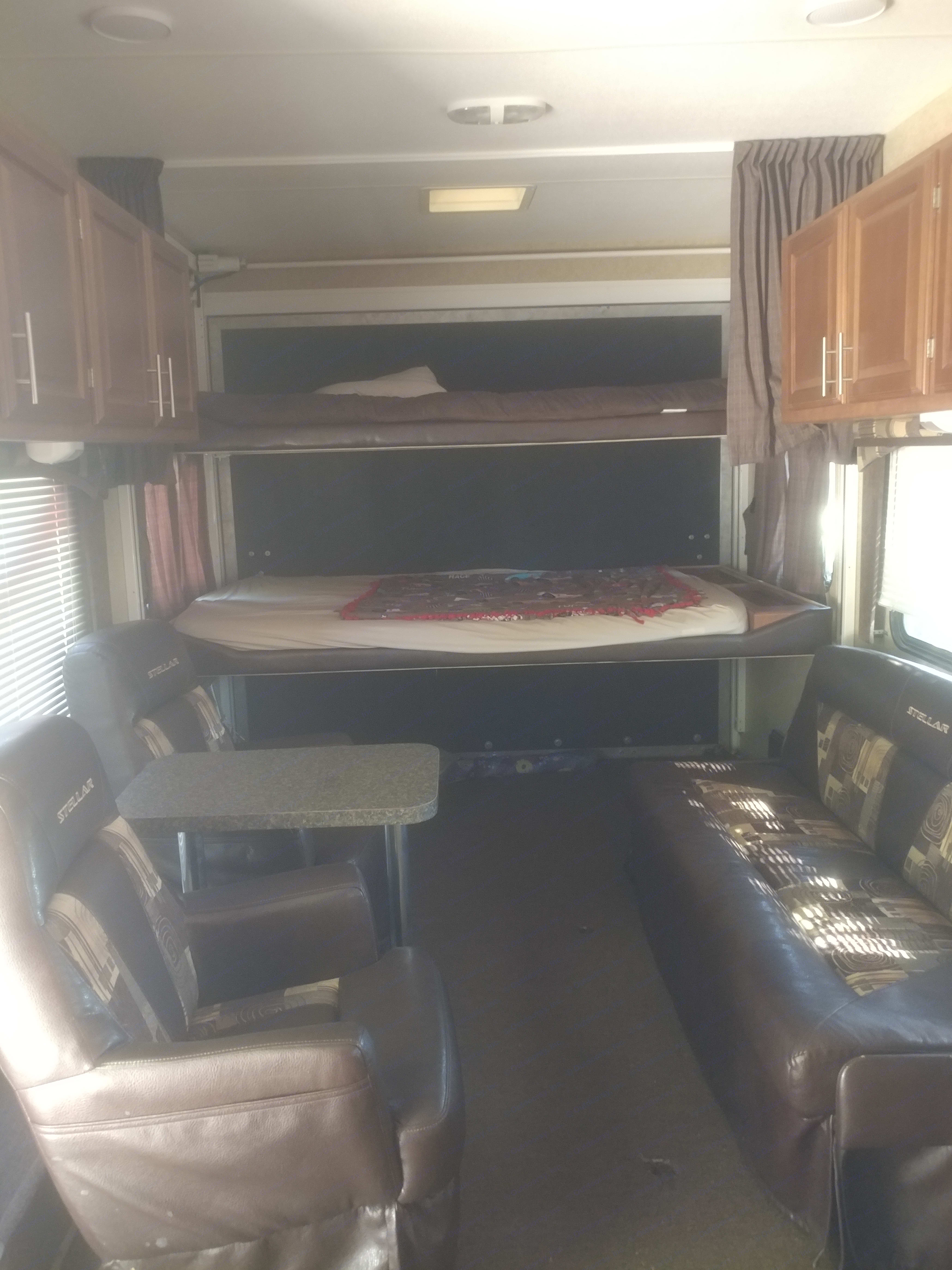 2 bunk beds go up, the couch folds up. The tables are removeable, captain seats go all the way to the master room so you can have room for your toys. . Eclipse Recreational Vehicles Stellar 2013