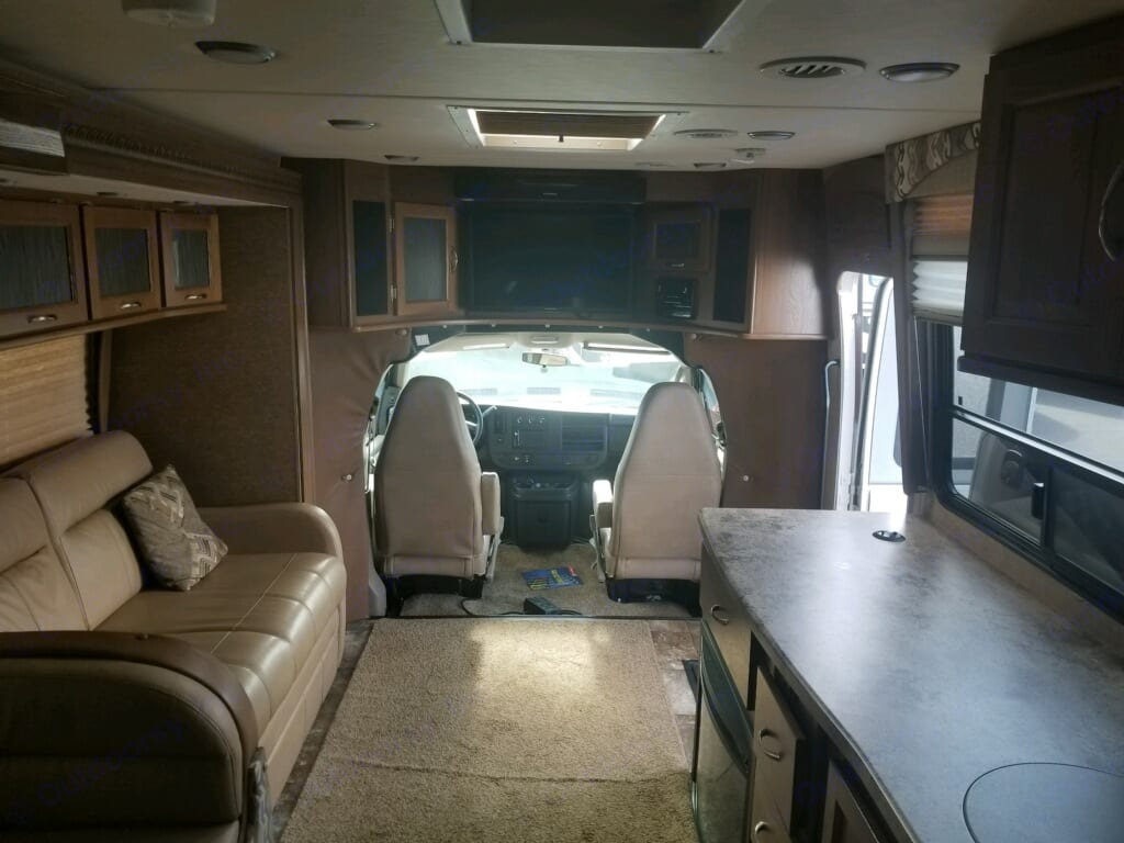 View of cab, couch,and large kitchen area.  Couch and table are a slide out.. Coachmen Concord 2016