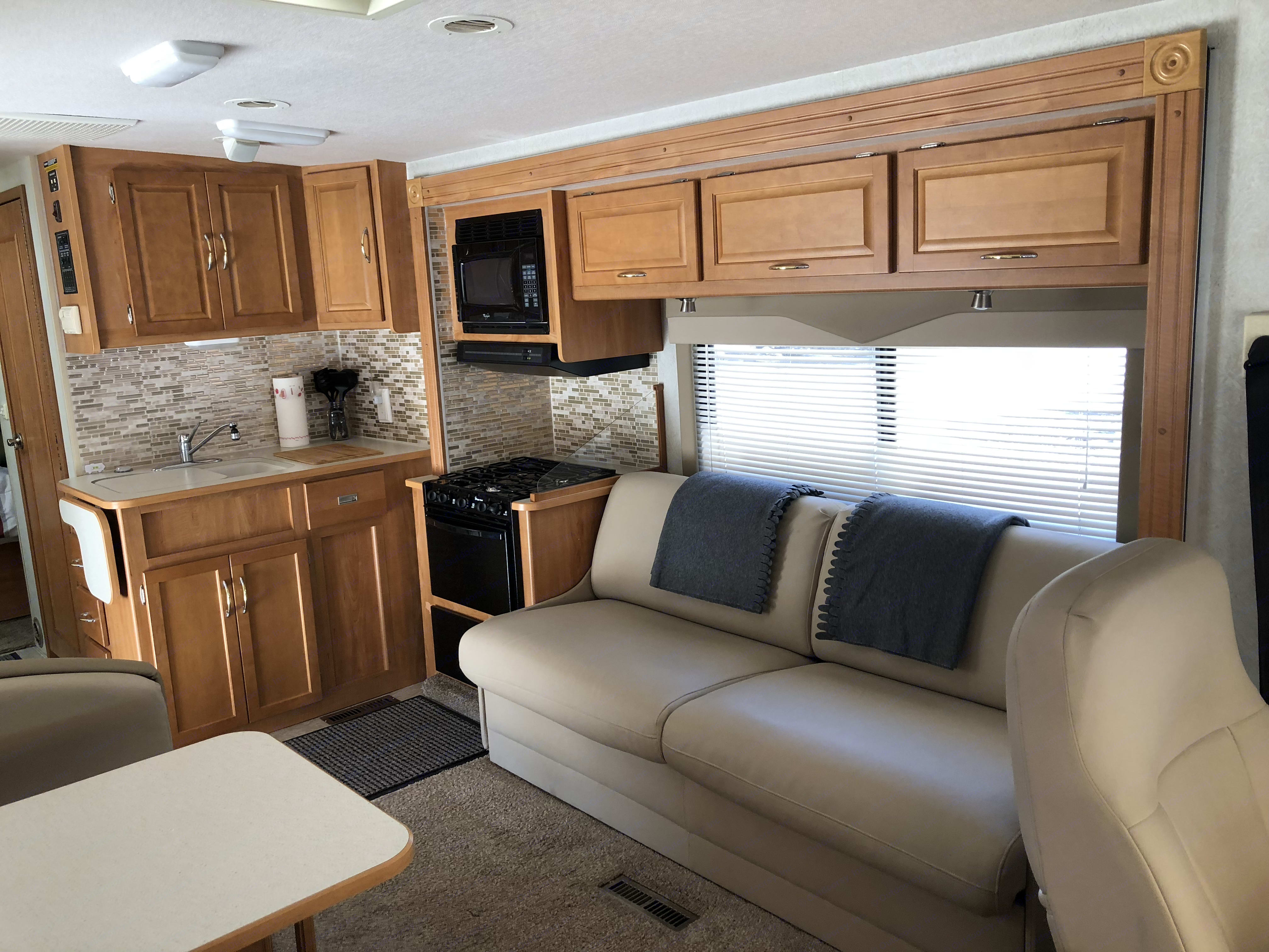Clean and spacious. Looking from the front to the back. With the slide out. . Itasca Sunova 2006