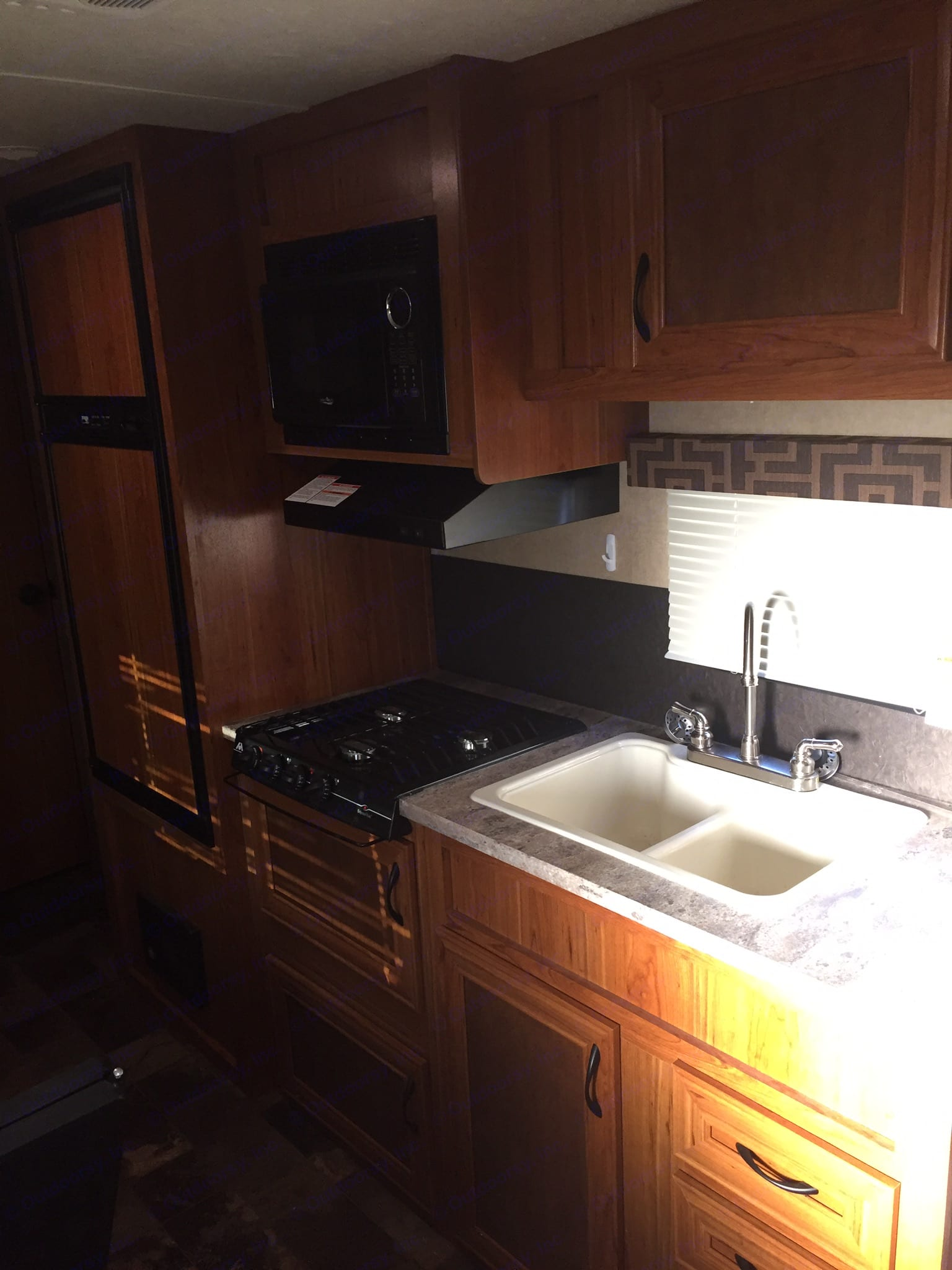 Kitchen has fridge, range with vent hood, microwave, and sink. . Starcraft Ar-One 2016