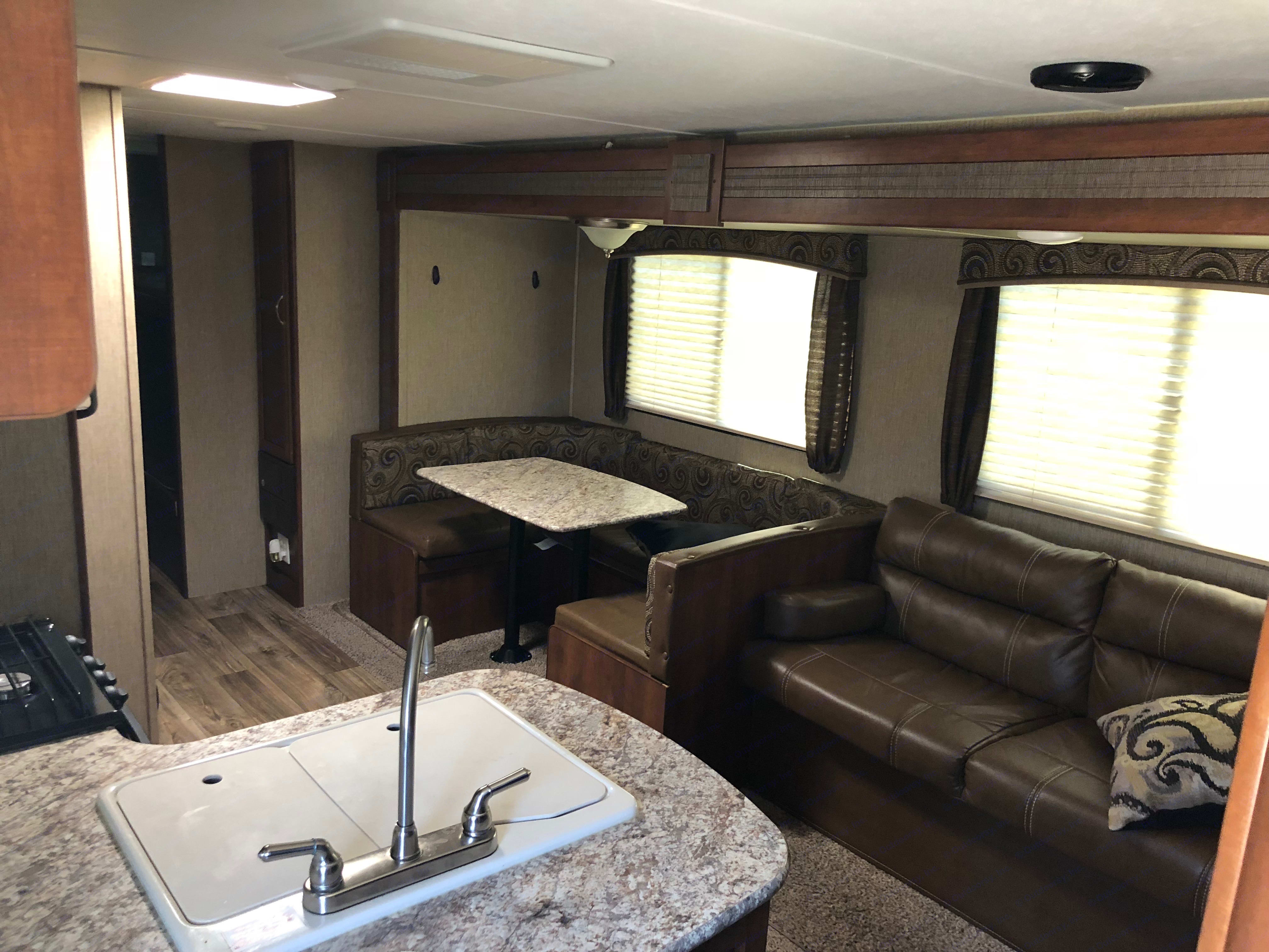 U shaped dinning table (folds down into a bed) and couch (folds down into a bed). . Keystone Passport 2017