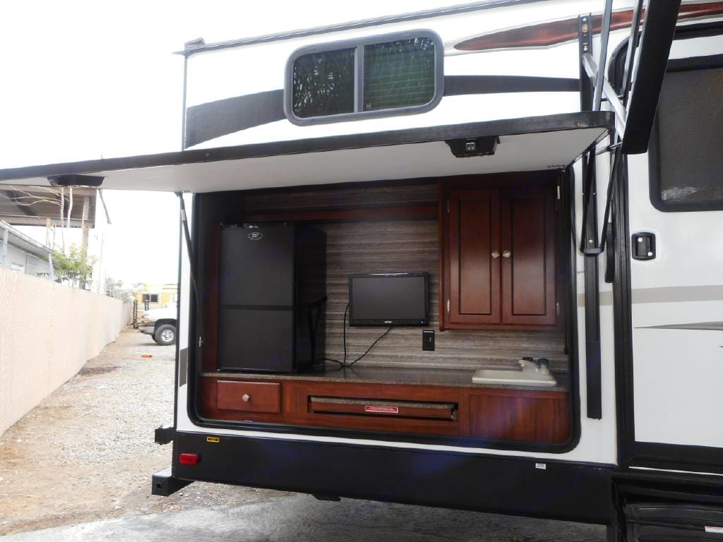 Outdoor kitchen with refrigerator and television.. Heartland Other 2018