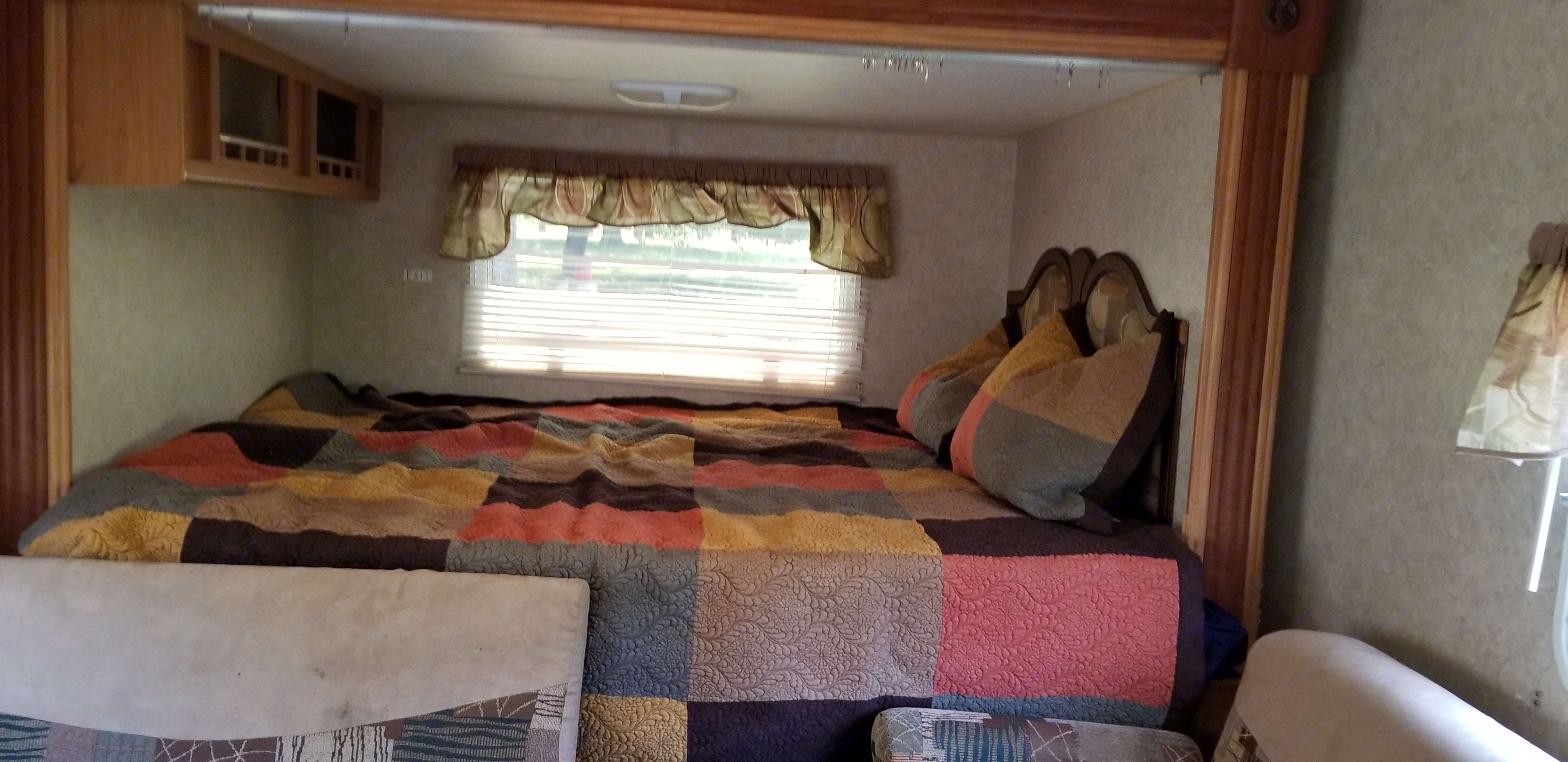 Queen side bed is a rear slideout . Aerolite Travel Trailer 2007