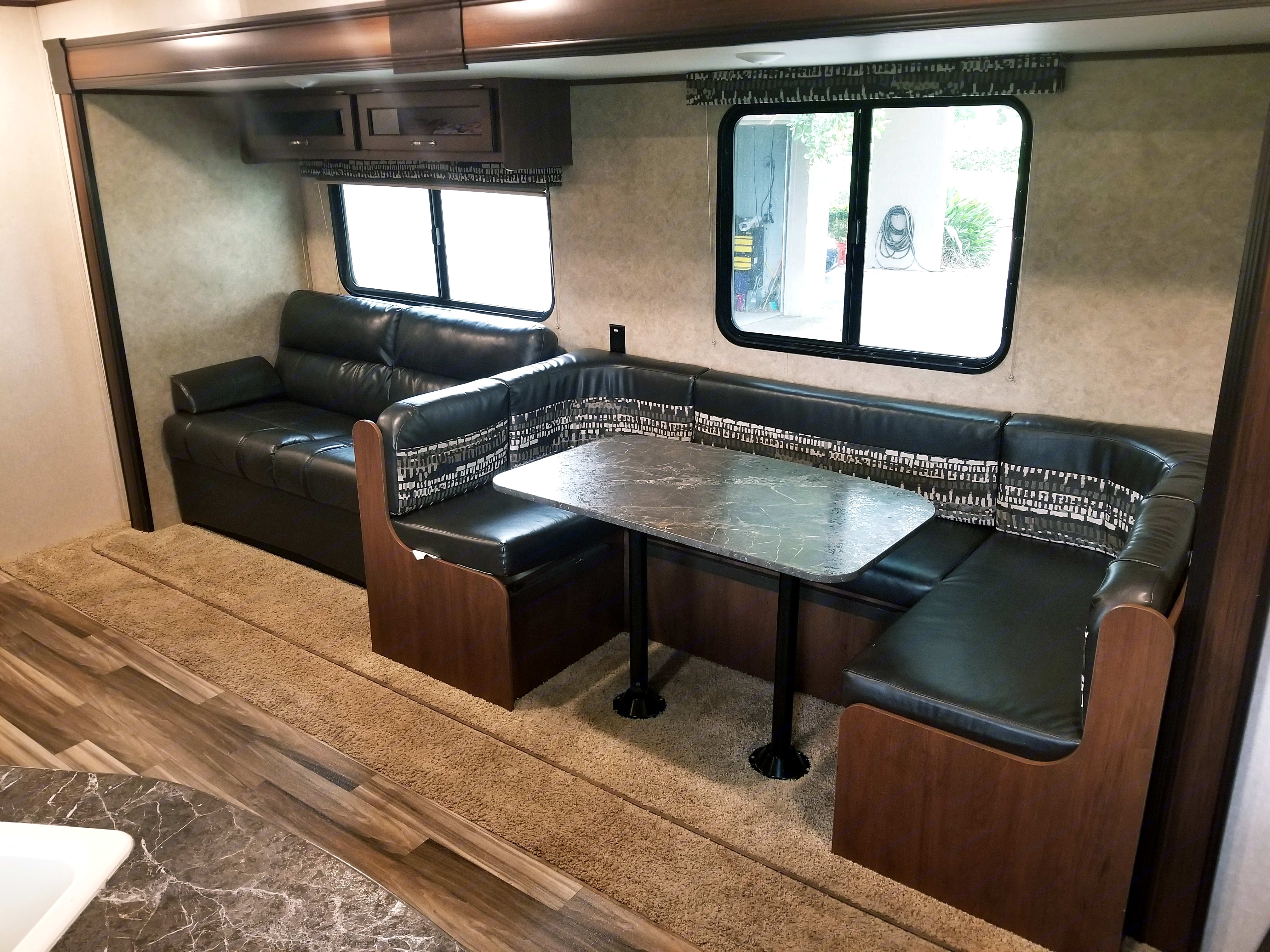 Sofa that converts to a bed, and a wrap around dinette that seats 5 comfortably. This is in addition to a bunk that features 2 full size beds, and a queen bed in the master suite.. Jayco Jay Flight 2017